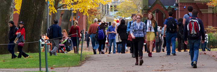 Crowds walking on college campus